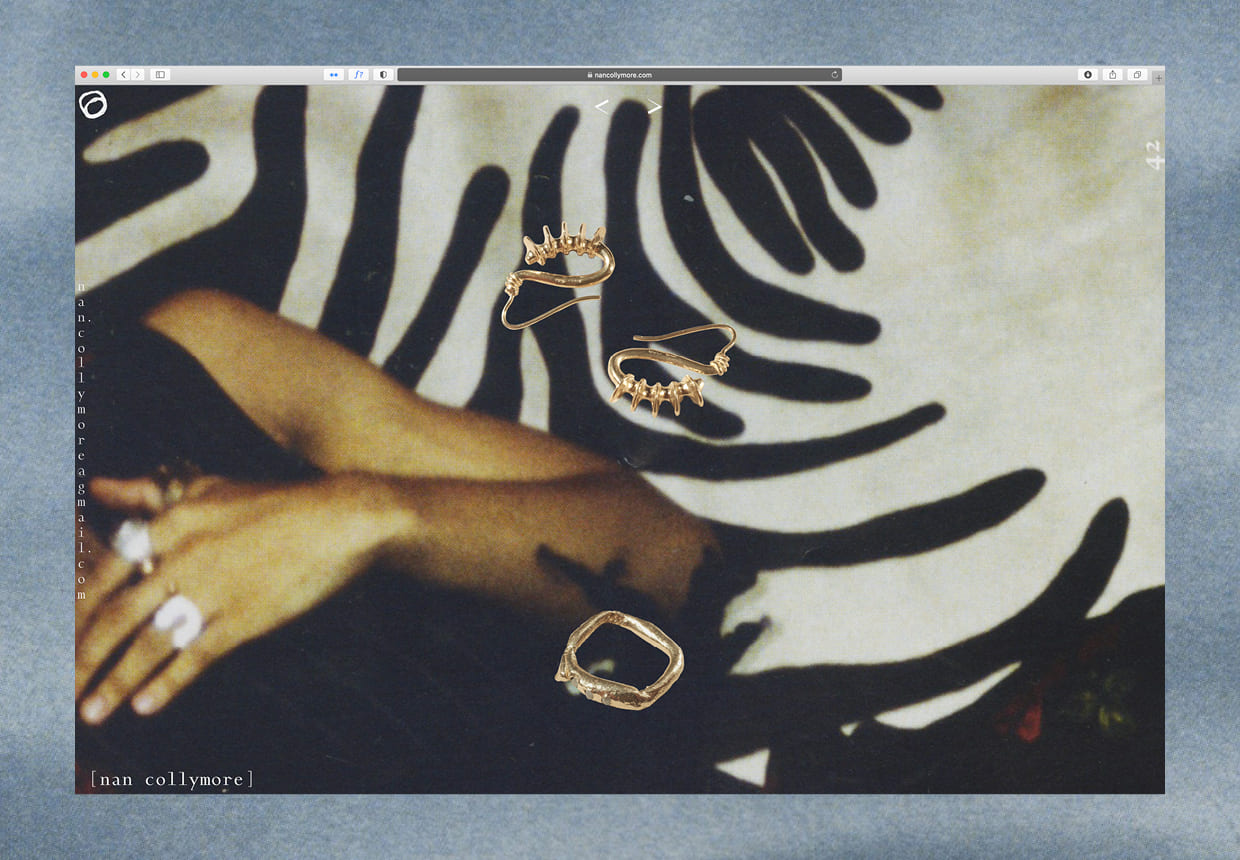 A screenshot of a webpage in a browser, containing cutout gold jewelry floating over a grainy image of an arm amidst black abstract forms. The jewelry is made by the artist nan collymore.