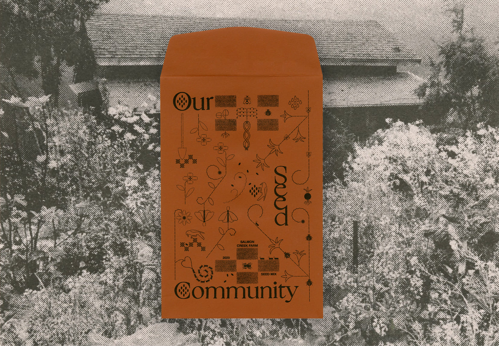 "A brown envelope illustrated with the words ""Our Seed Community,"" floating over a black and white image of a cabin and a garden at Salmon Creek Farm. Illustrations of seed distribution also decorate the envelope."