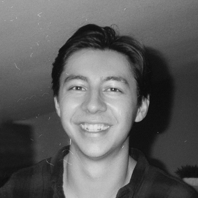 A black and white picture of myself smiling.