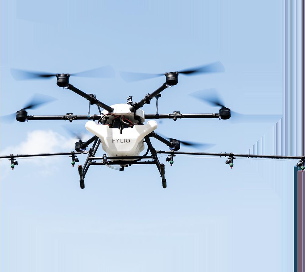 Crop spraying drone flying
