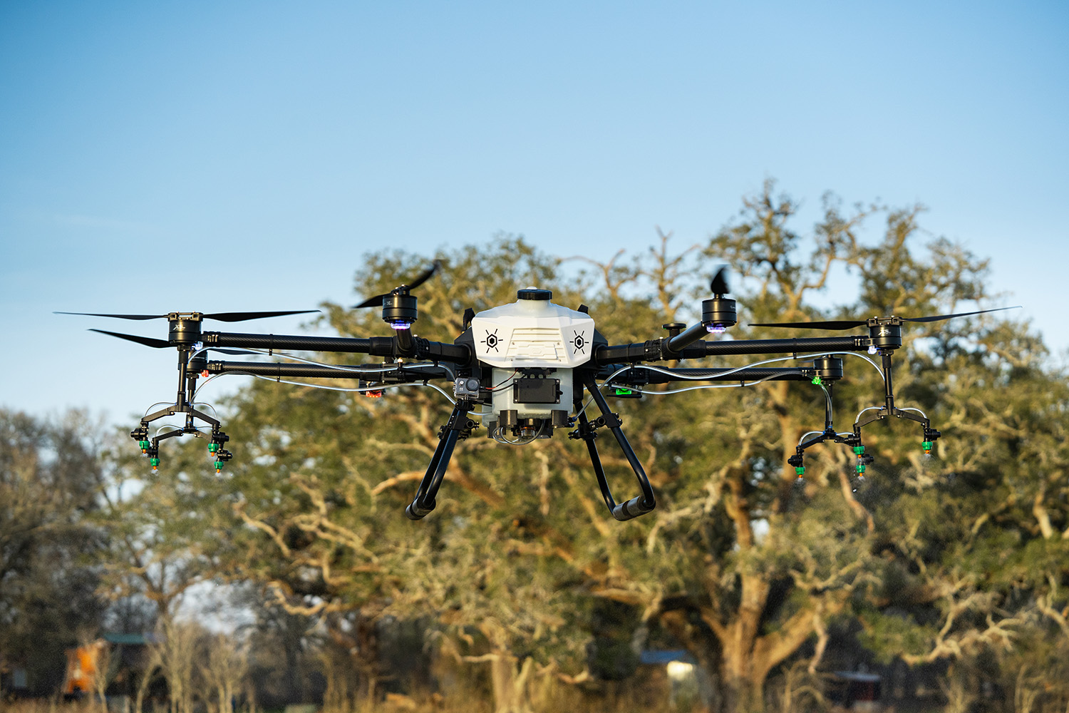 large agricultural spray drone flying