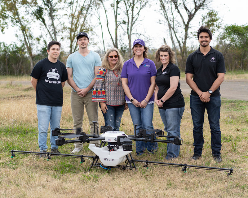 Customers with a Hylio Spray Drone