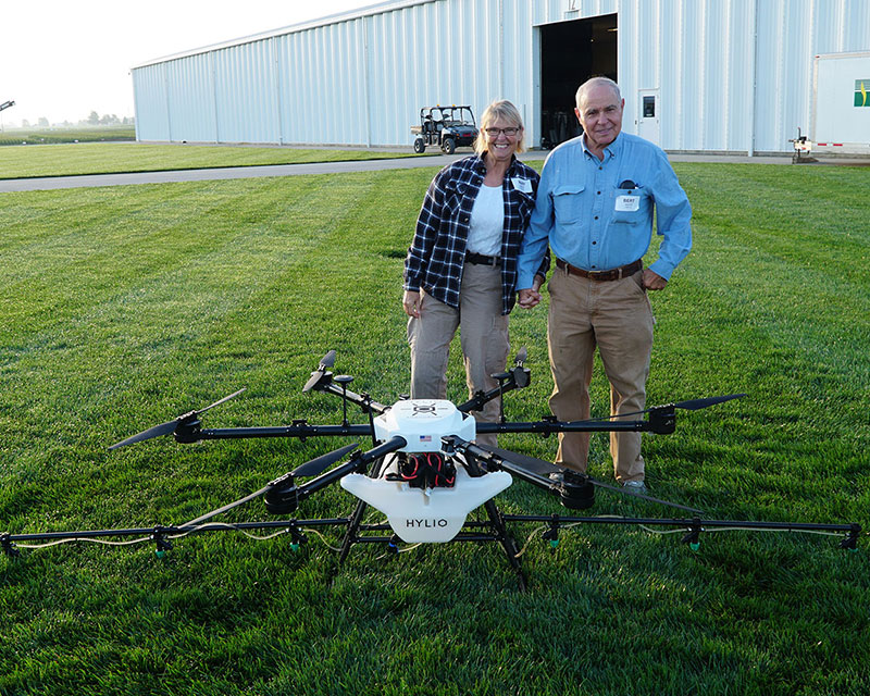 Customers with crop spraying drones