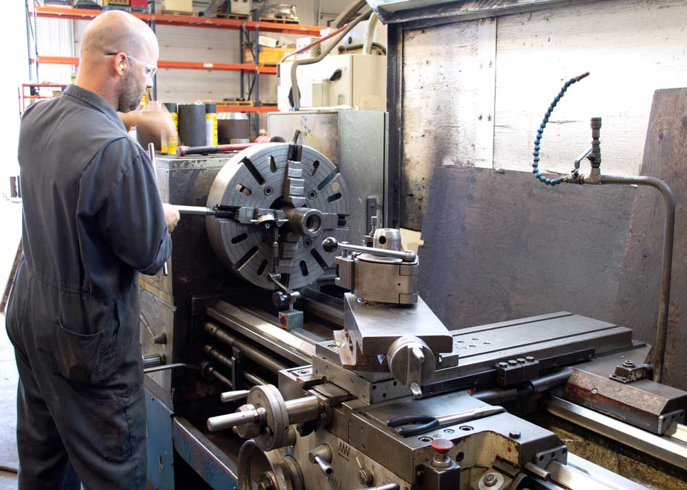 Orion worker doing CNC and manual machining