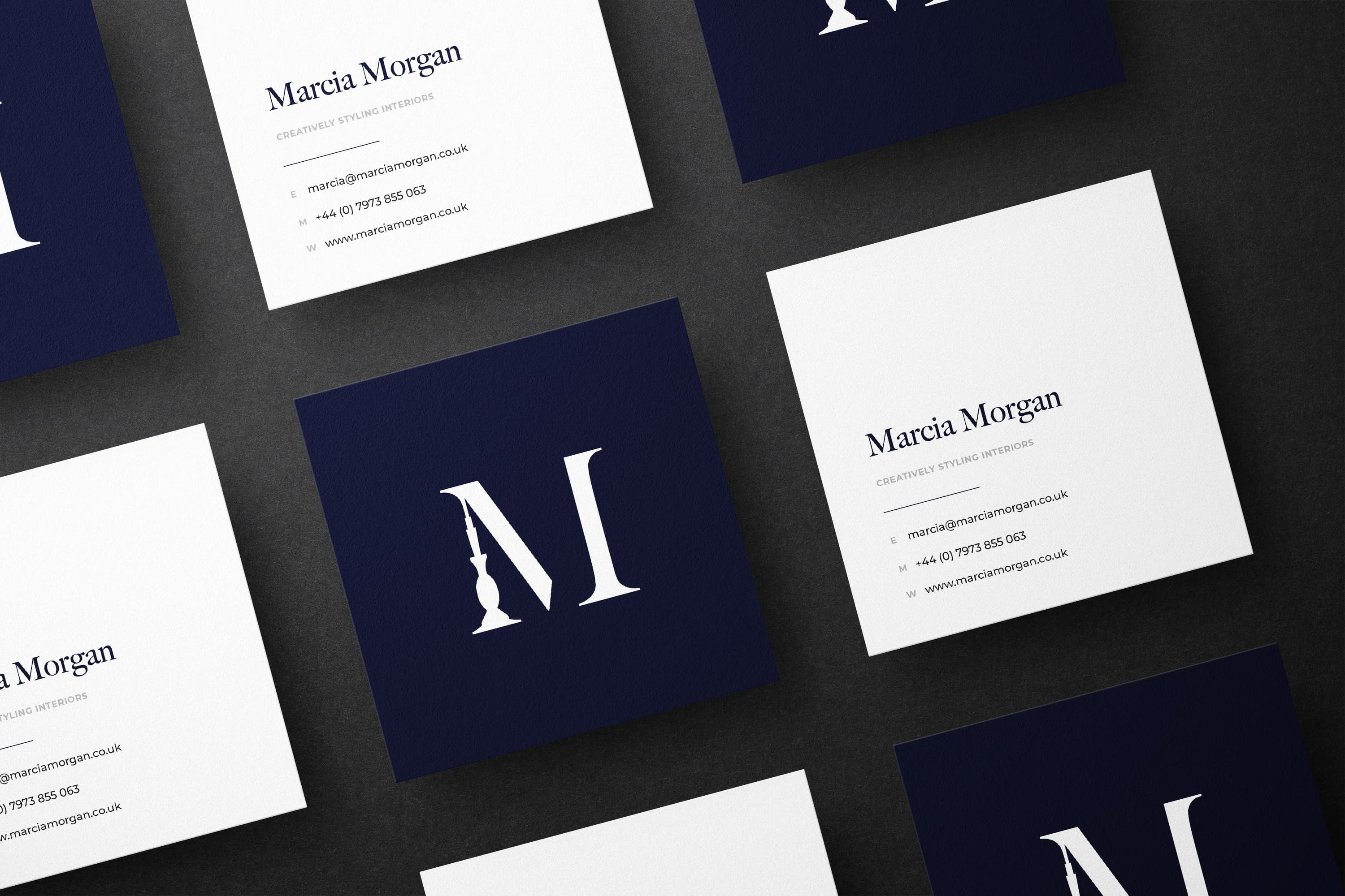 A row of Marcia Morgan business cards
