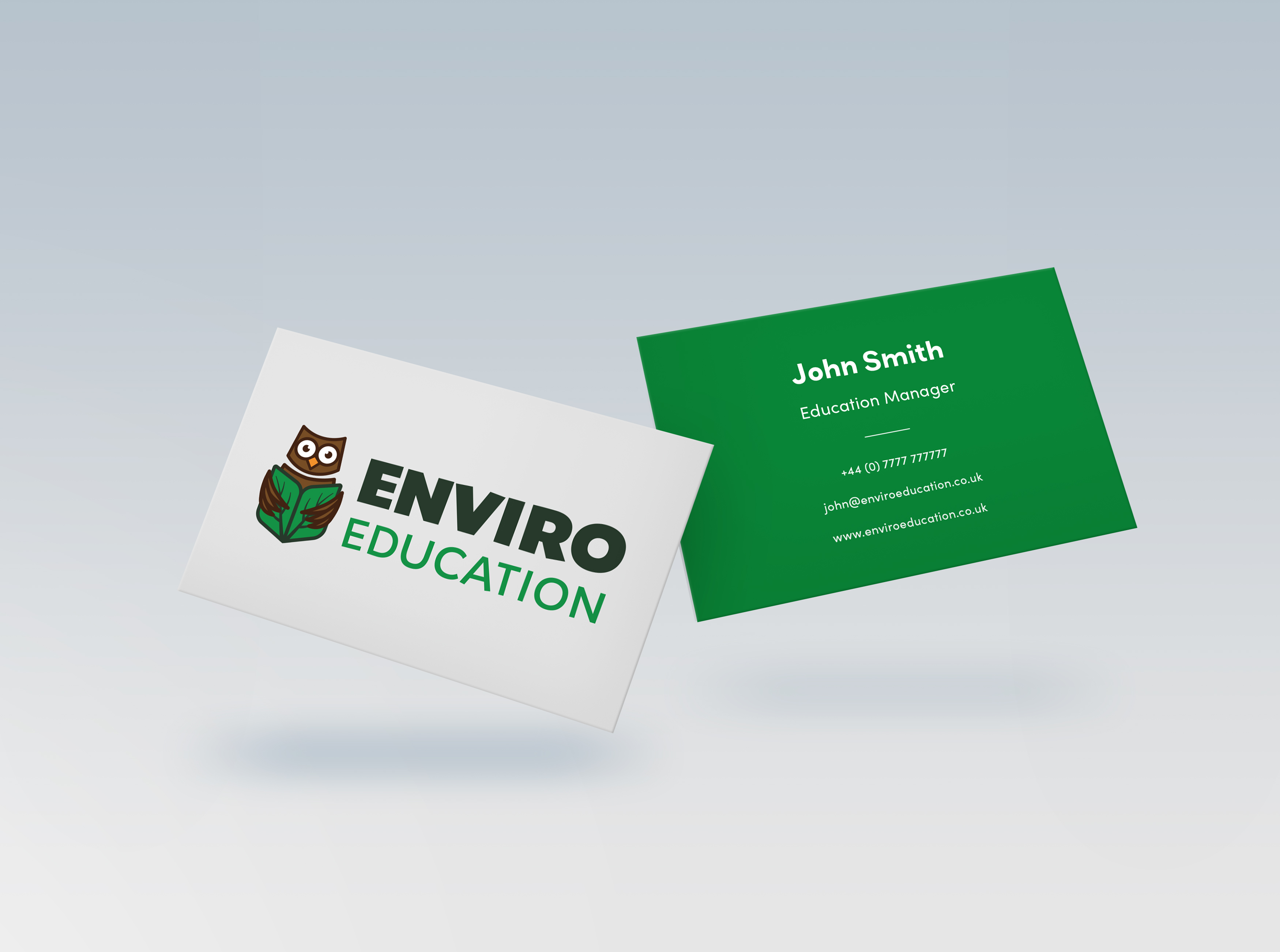 Two floating business cards from EnviroEducation