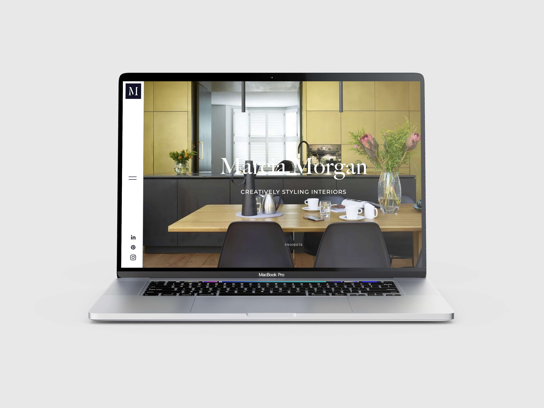 Marcia Morgan website open on a laptop