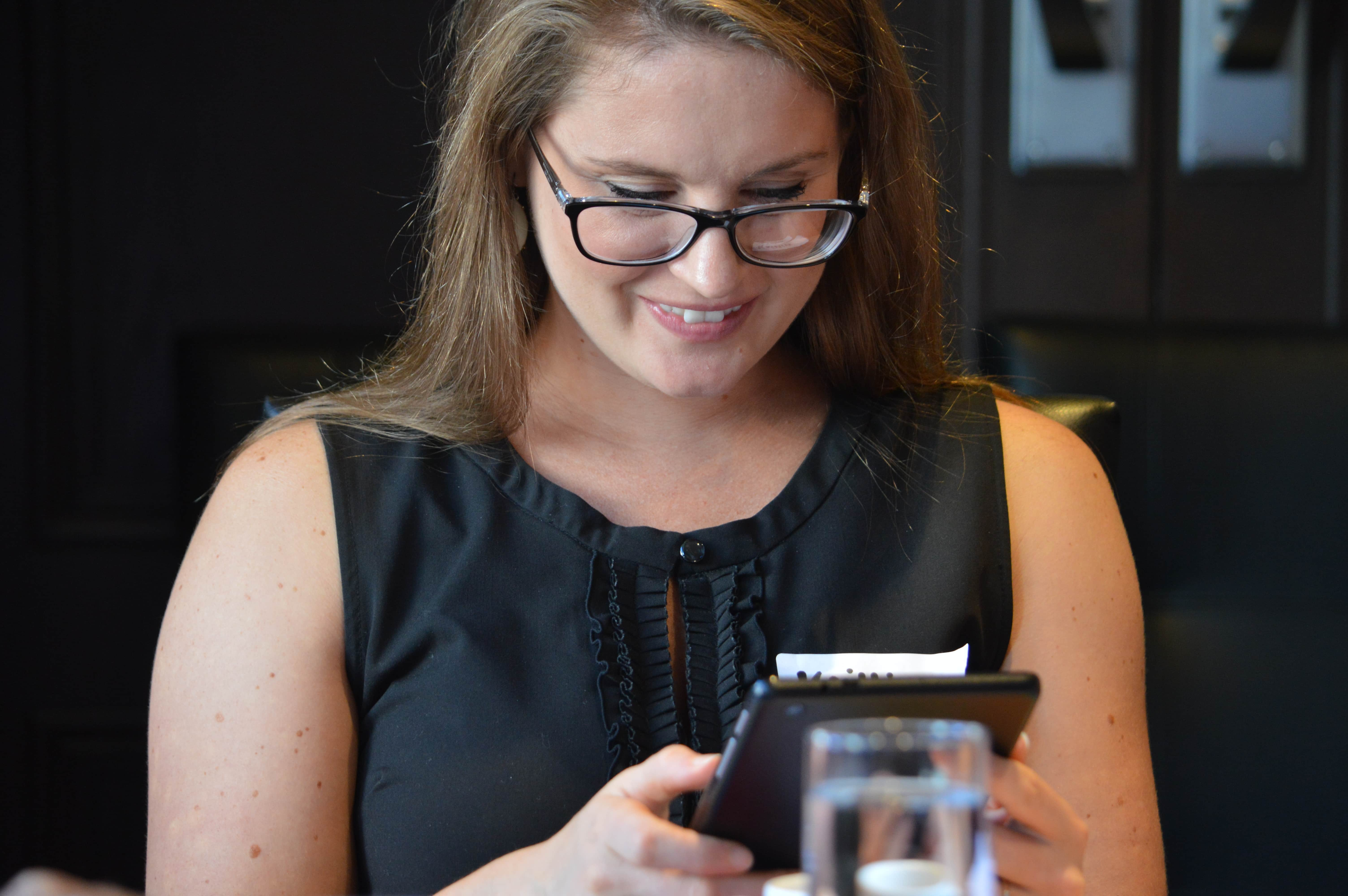 Happy woman looking at tablet