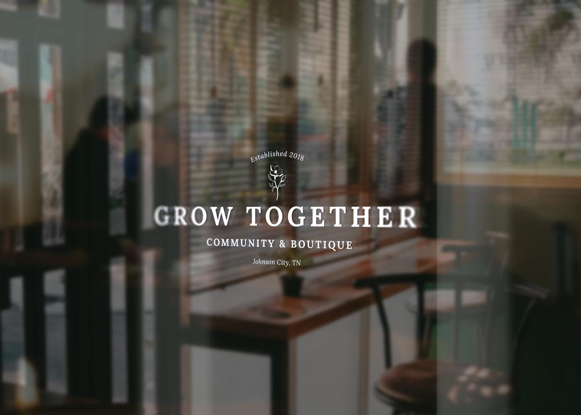 Logo design mockup on glass door for Grow Together • created by Goodness design and marketing in Raleigh NC