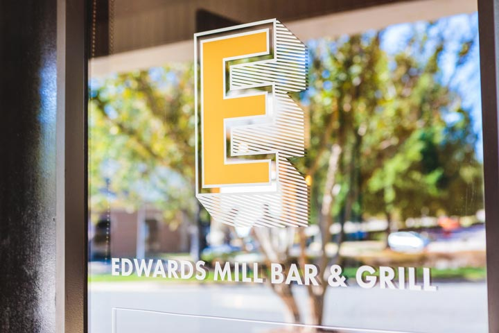 Logo identity design for neighborhood hangout spot Edwards Mill Bar and Grill in Raleigh • created by Goodness brand agency