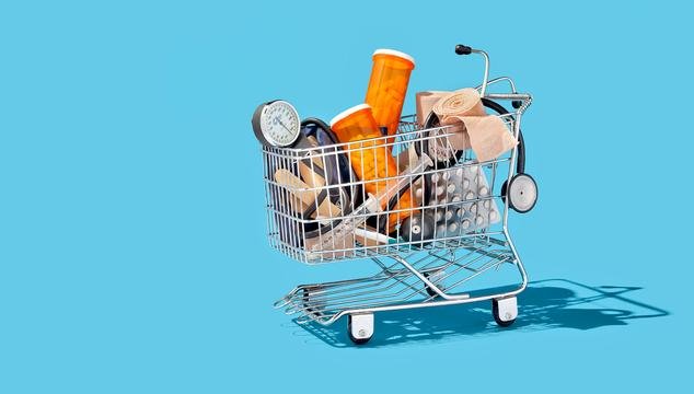 shopping cart with pills and doctor equipment