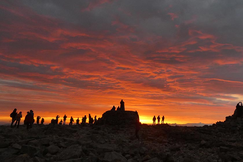 Walkers atop Ben Nevis,  silhouetted against a Solstice sunrise.