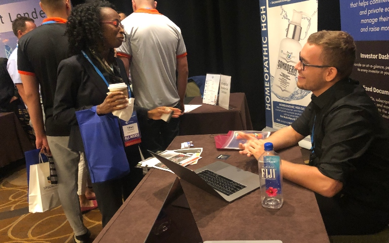 Jesse talking to a multifamily investor at Ultimate Partnering 2019 in Boston