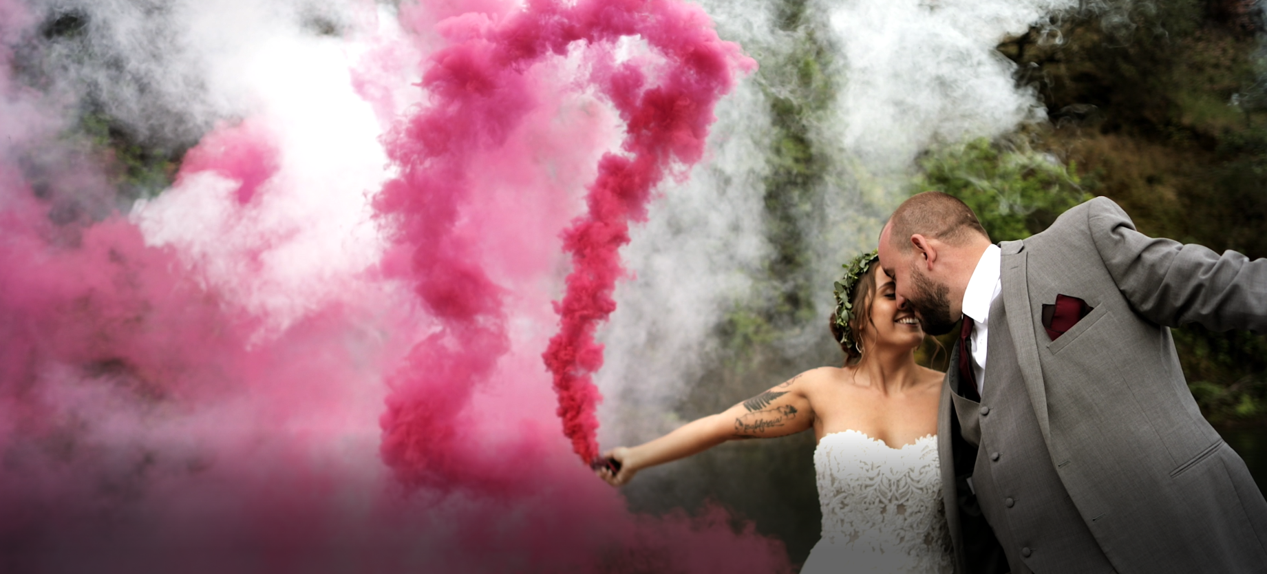 Bride and Groom holding smoke bombs for their wedding video