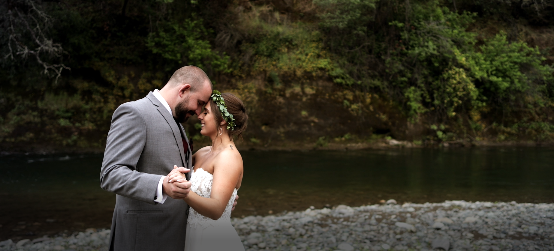 Bride and Groom dancing along the creek at Centerville Estates in Chico, Ca