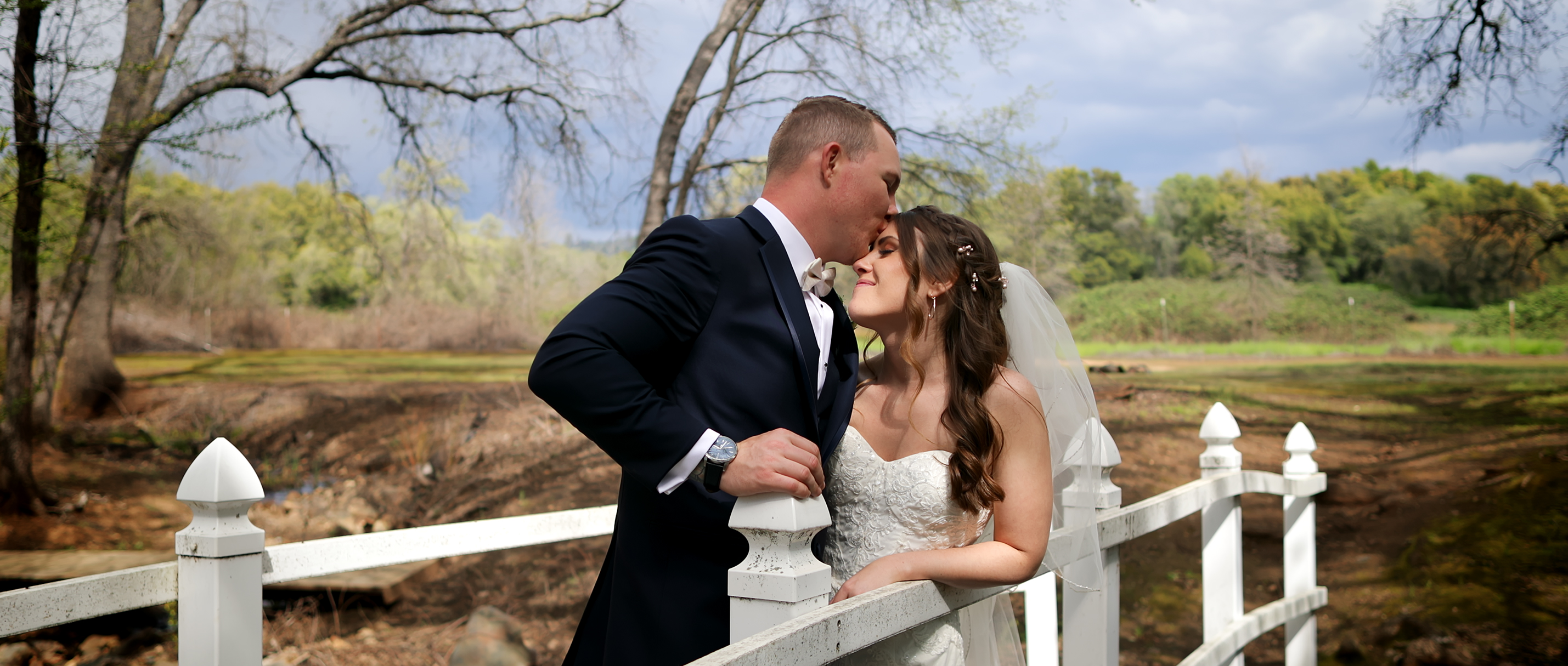Groom kissing brides forehead from wedding filmed in Marysville, ca