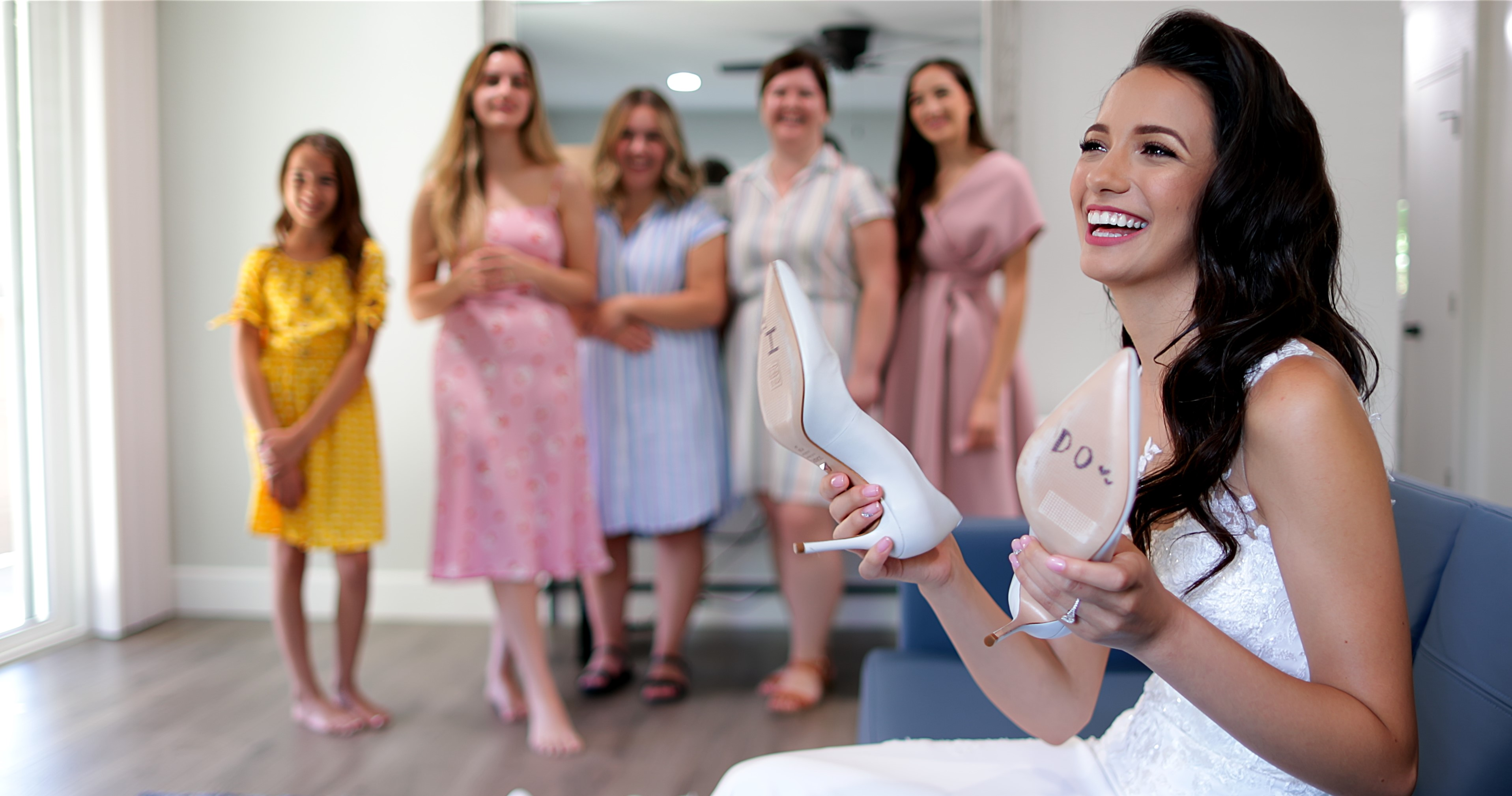 """Bride holding shoes that say """"I Do"""" for Sacramento wedding"""