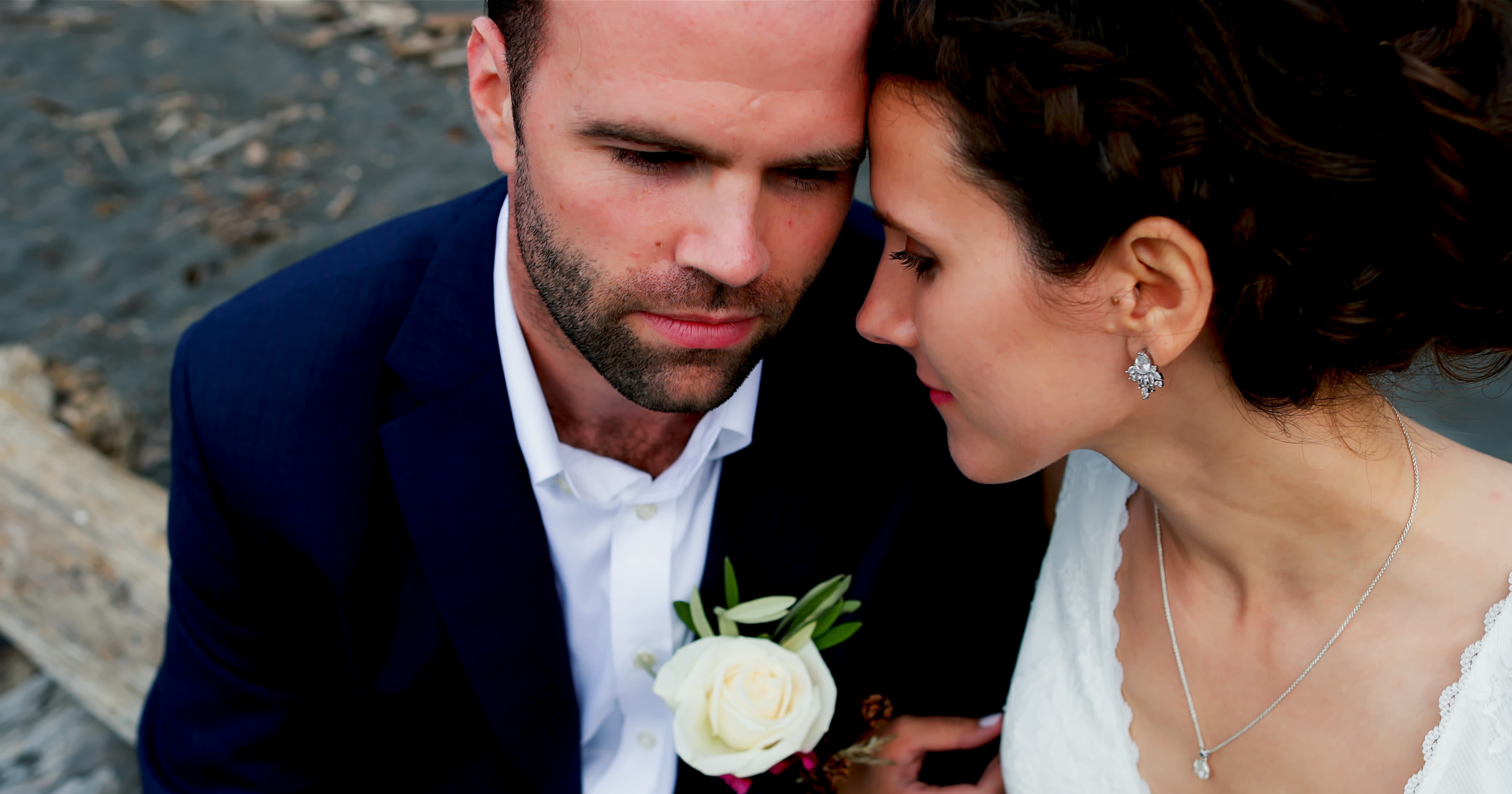 Bride and Groom cuddling on the beach of Crecent City for their wedding video
