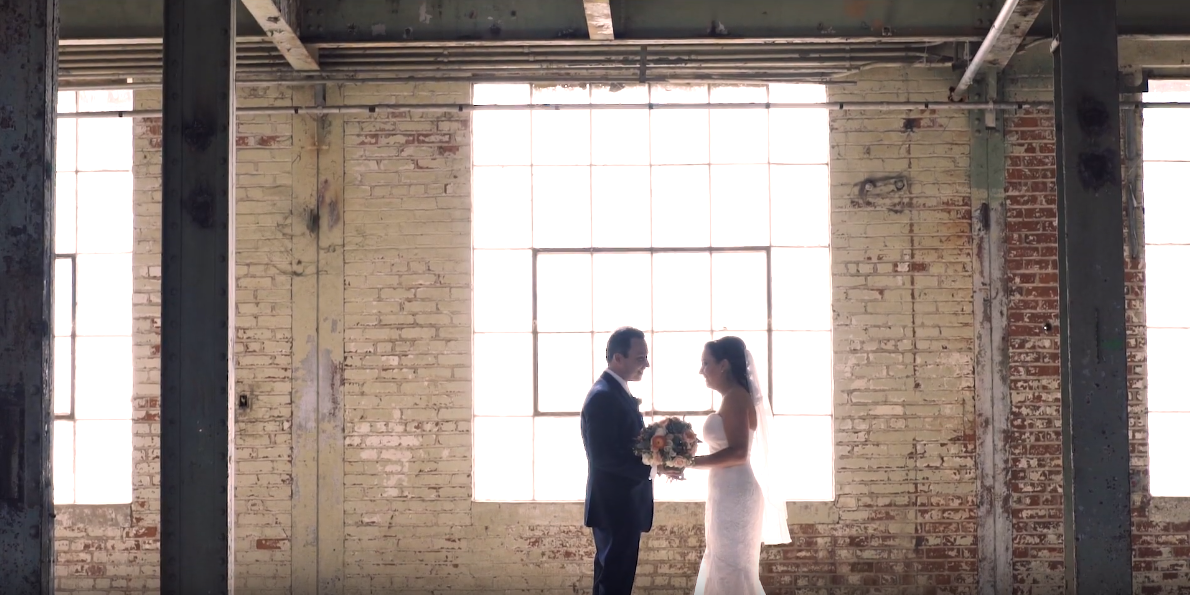 Bride and Groom facing each other happily in a warehouse in Sacramento, Ca
