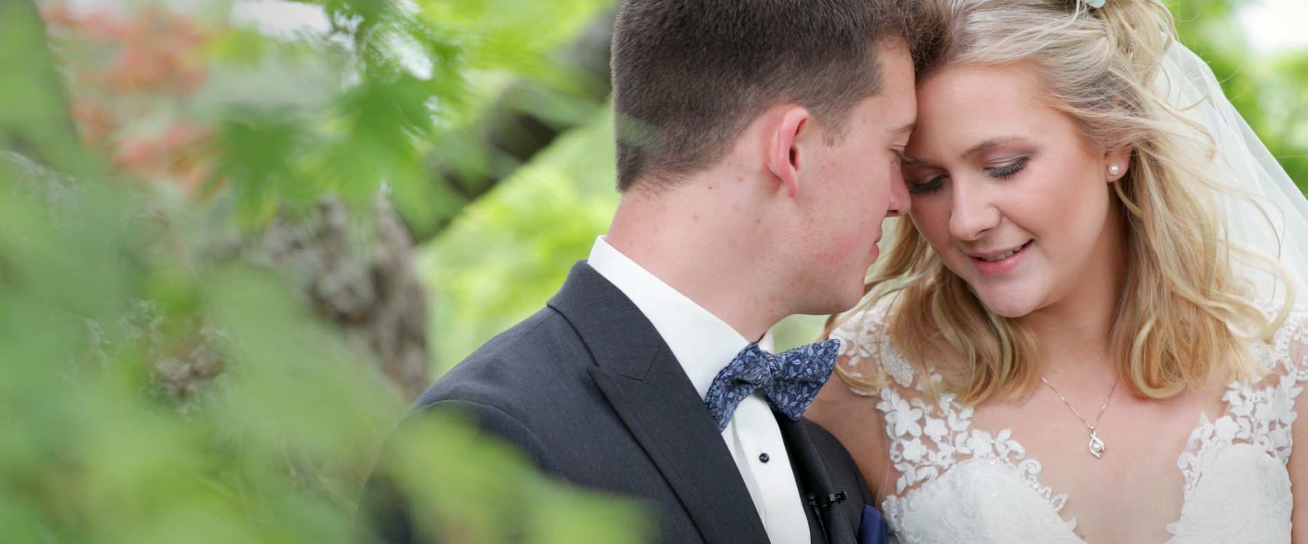 Bride and Groom kissing in pasture for their wedding video