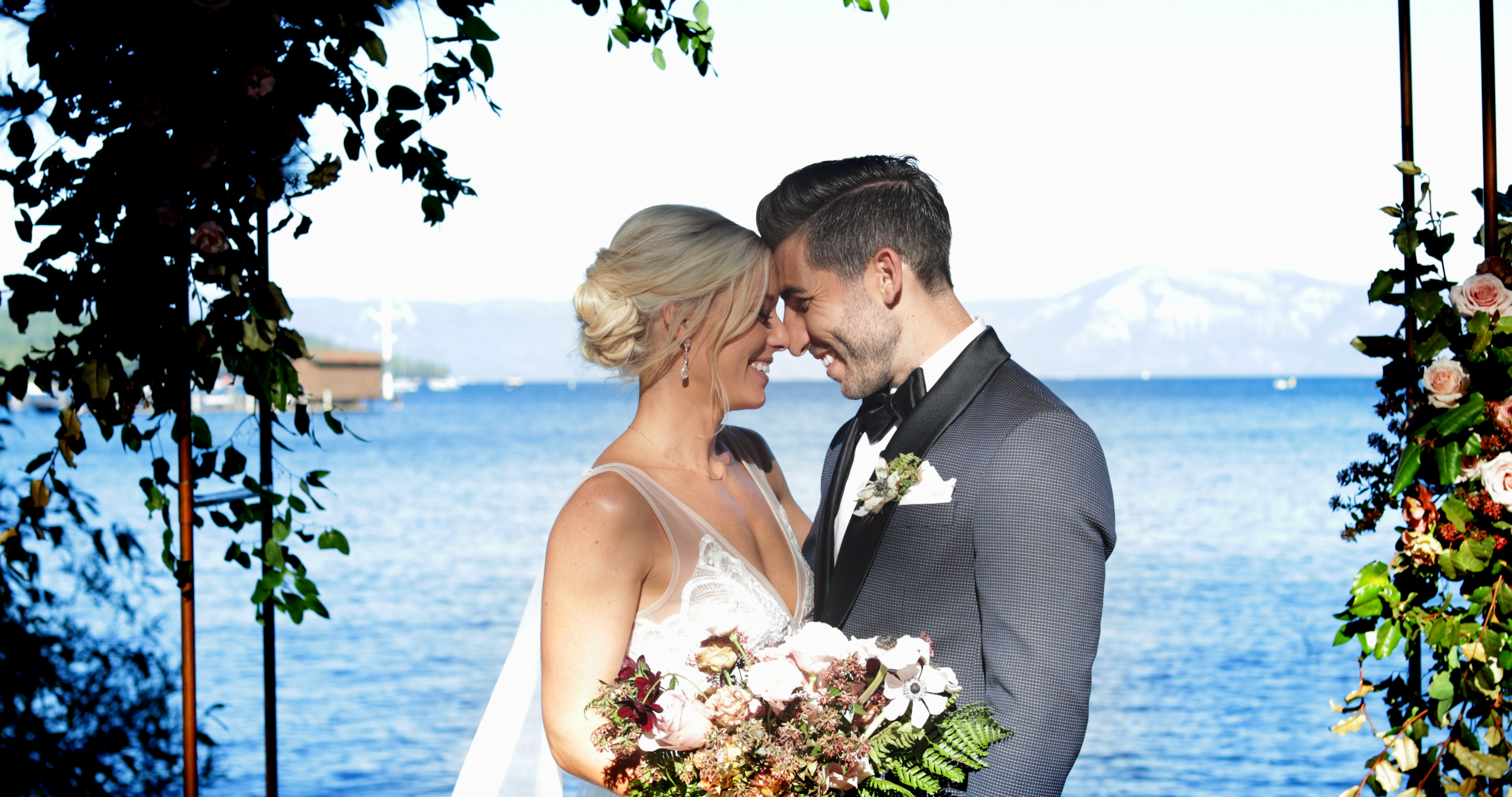 Bride and Groom cuddling in front of the lake in Tahoe City, Ca