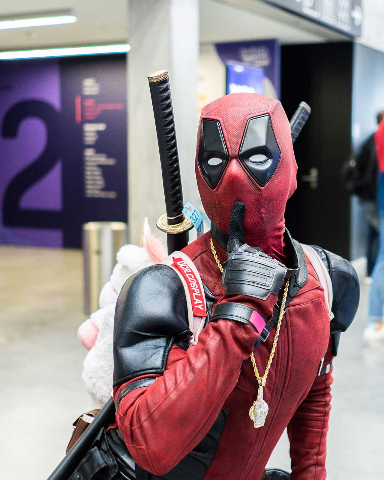 Cosplayer dressed as Deadpool at TwitchCon EU in Berlin.