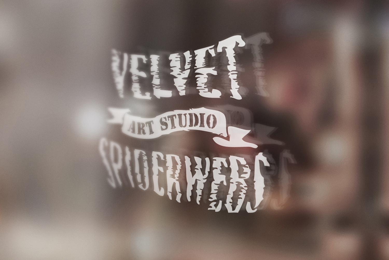 Velvet Spiderwebs door logo