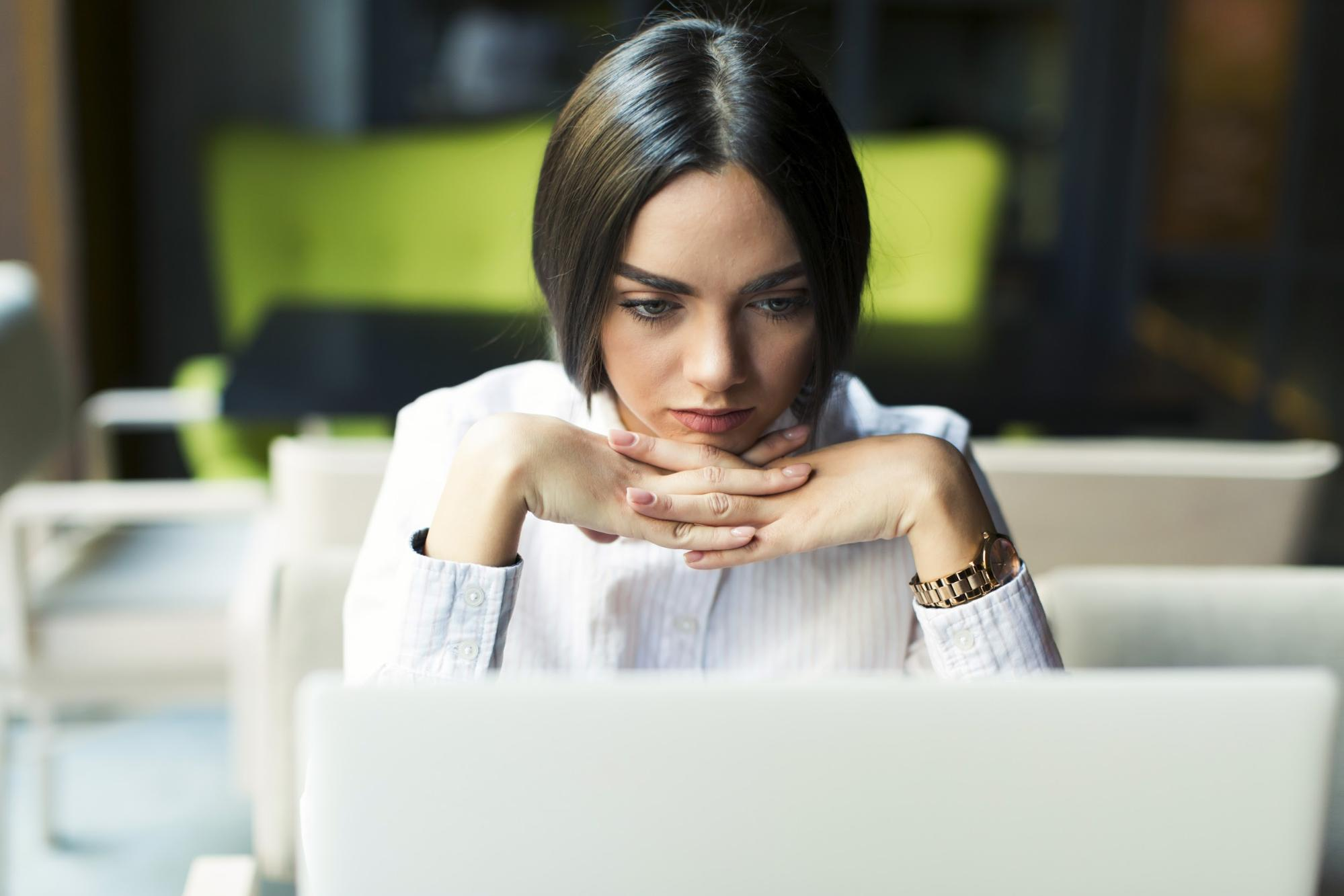 focused woman working with laptop