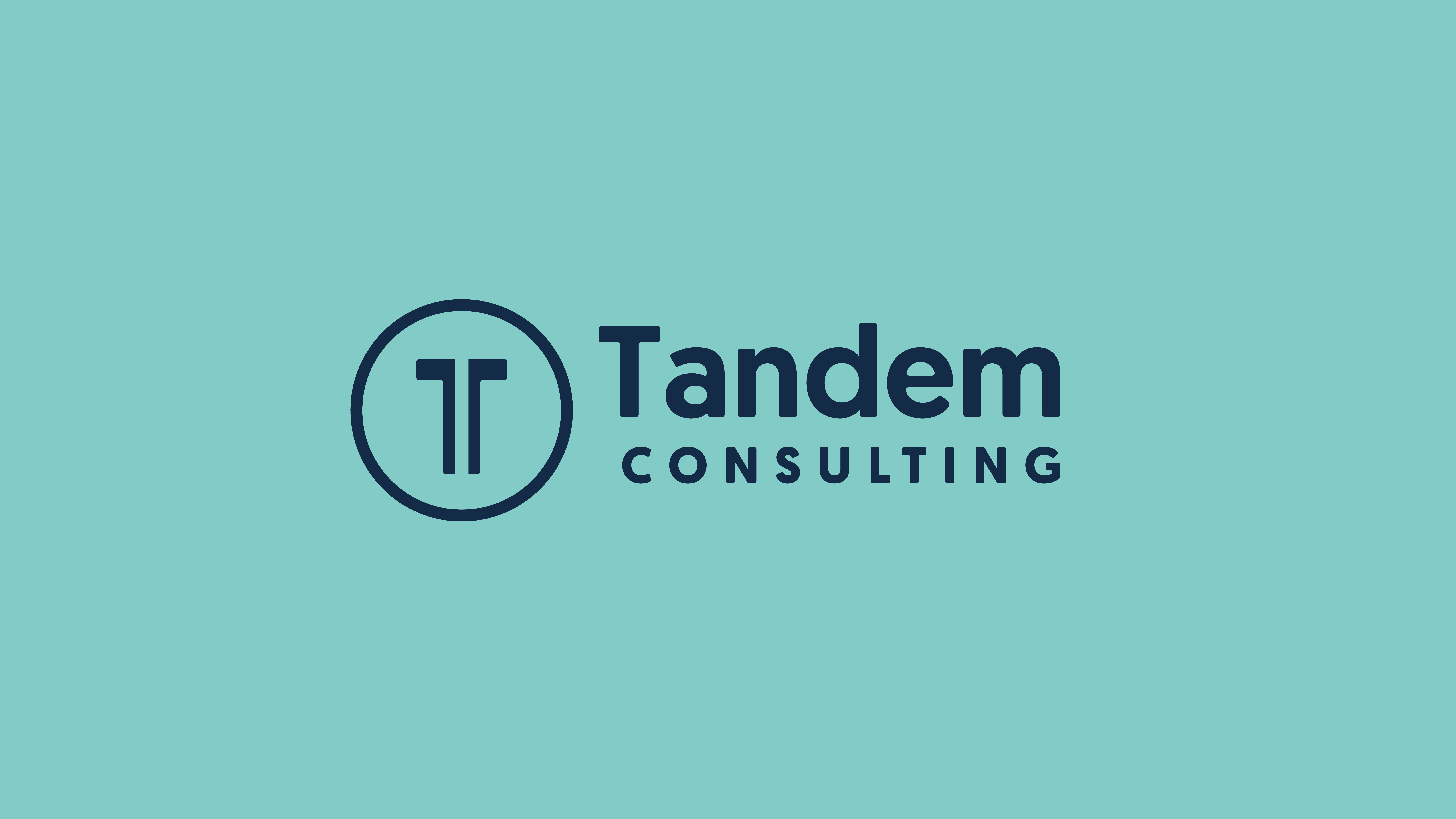 Tandem Consulting Logo. Blue against teal. The Tandem brand logo is the letter T split in half with a circle around it. This signifies that Tandem works with you but helps you to be independent.