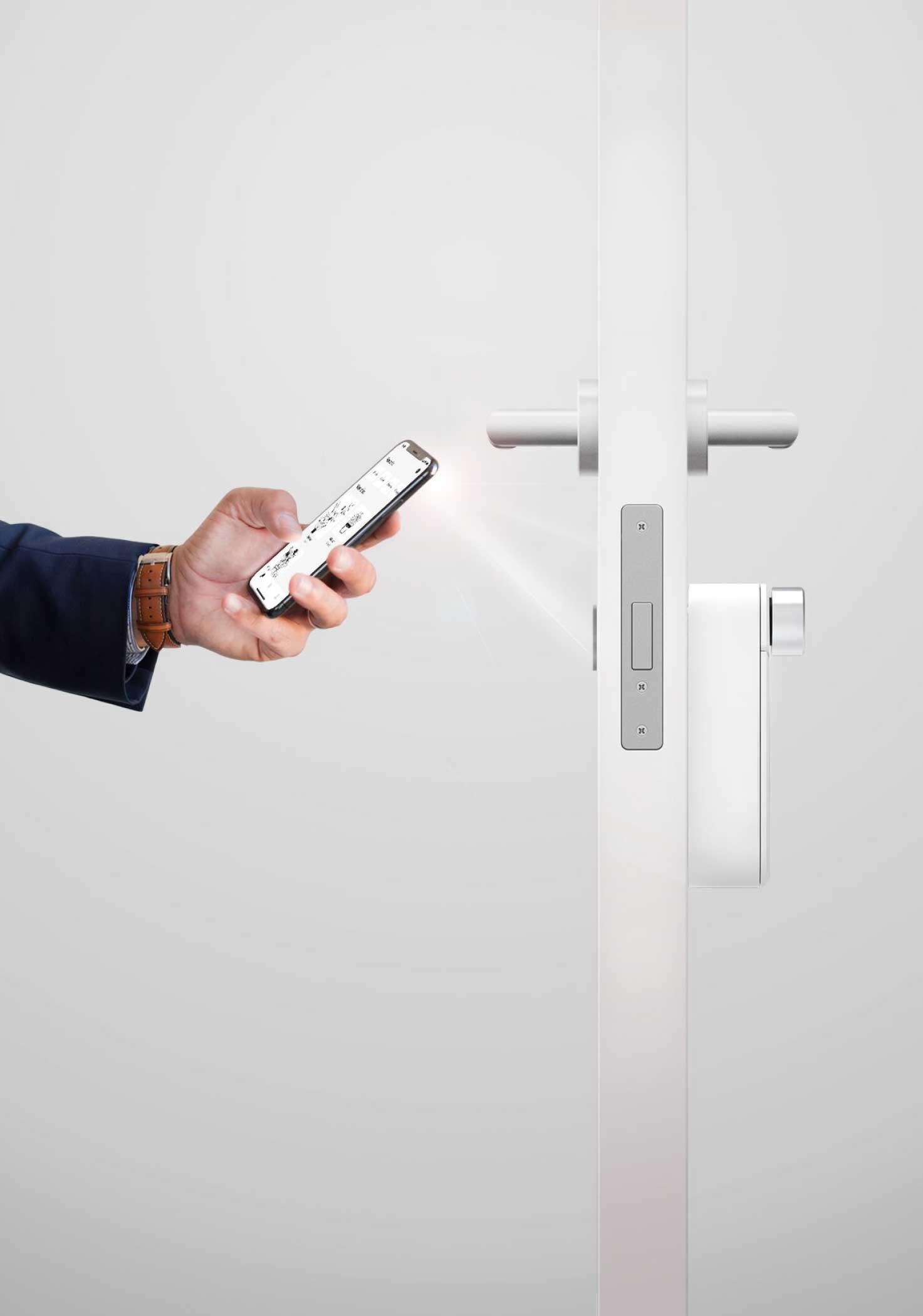 Man using smartphone to flash the BrightLock smart lock