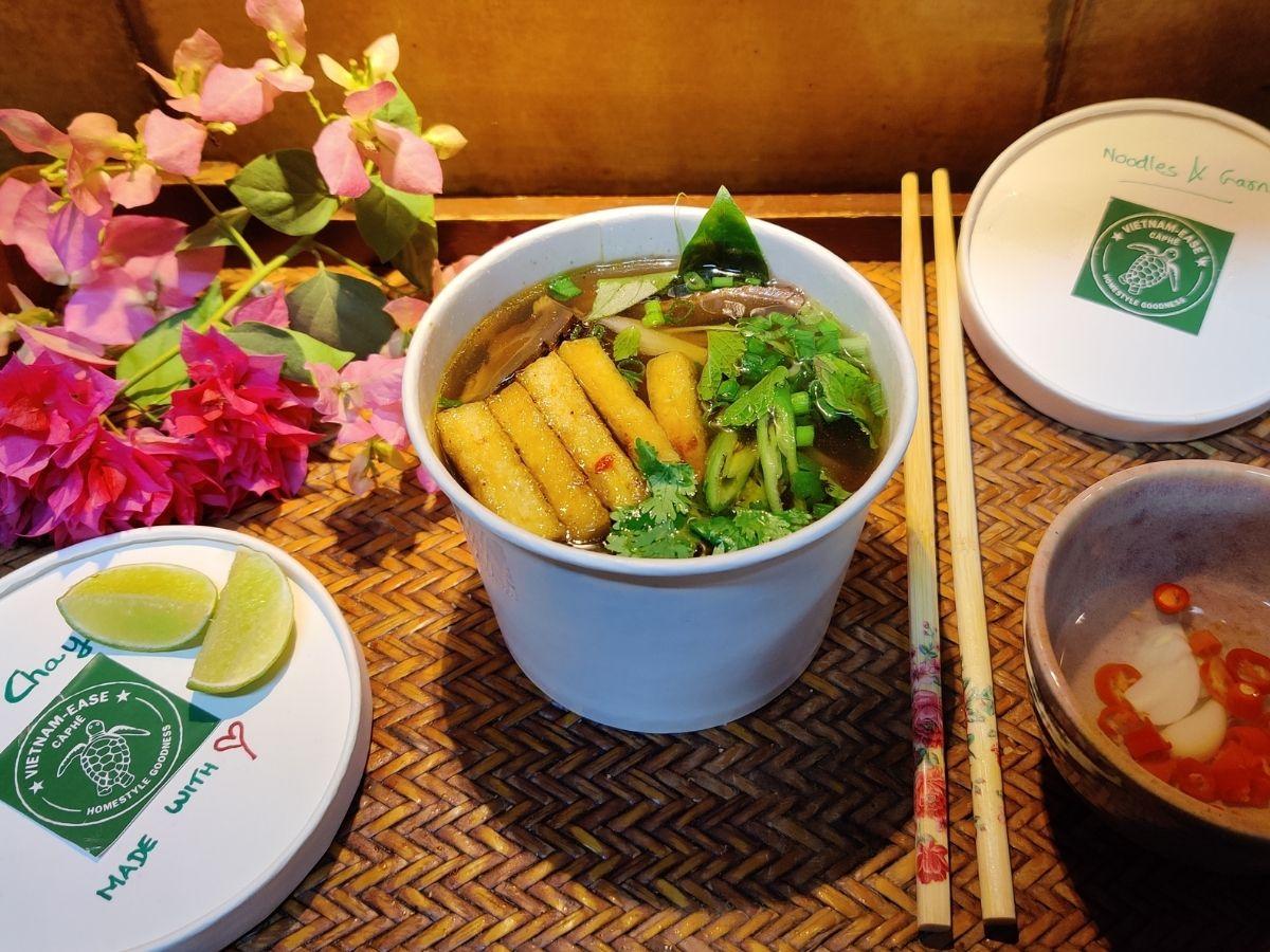 Vegan pho, Vietnamese noodle soup with tofu, vegetables, and shiitake mushroom