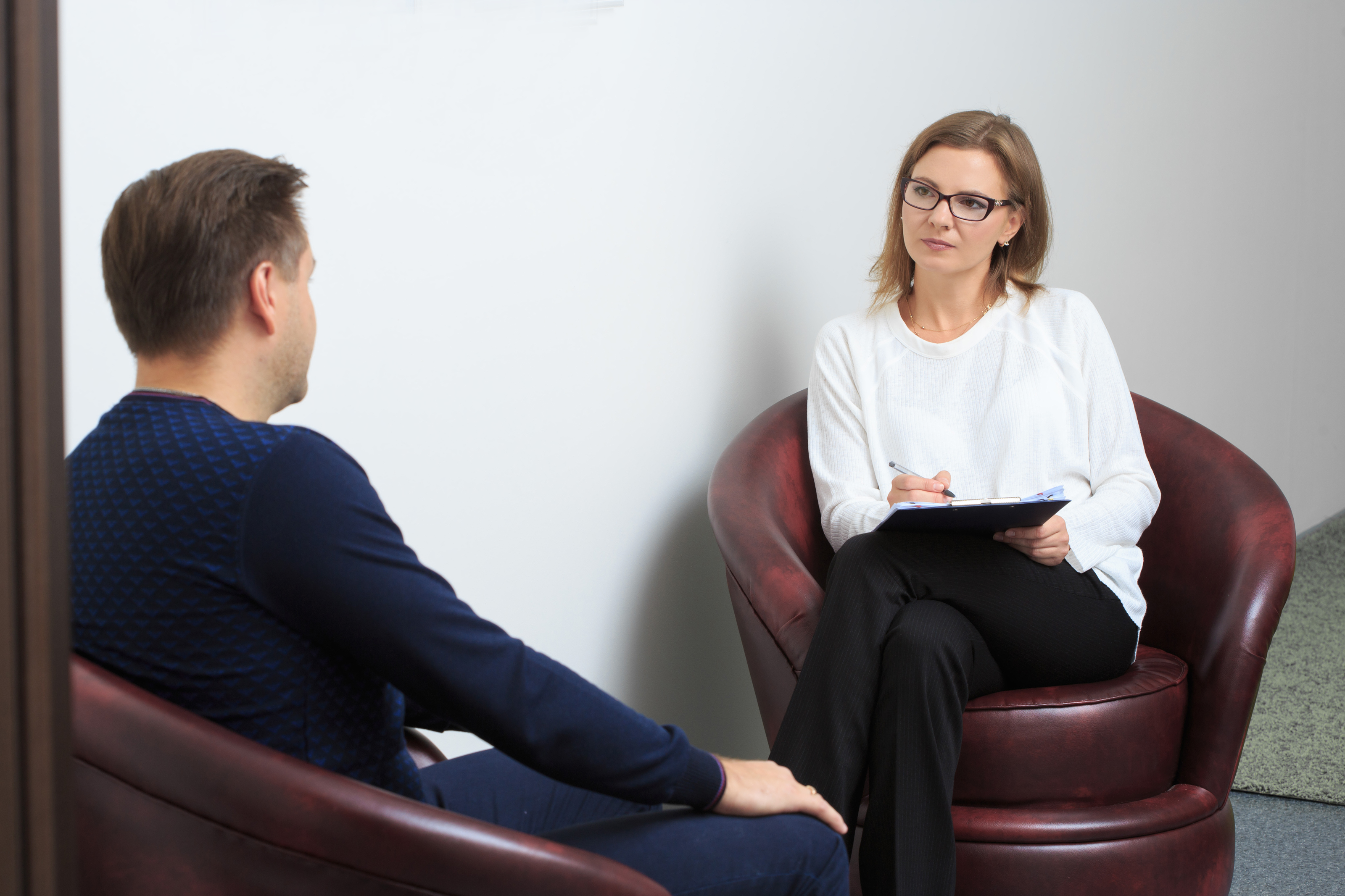 Counsellor with client sitting opposite each other
