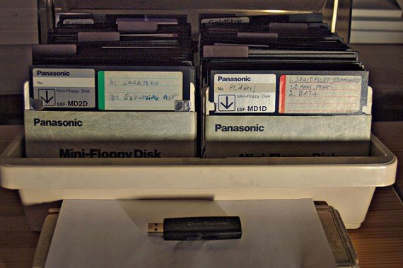 """Box of floppy disks and USB memory stick"" by JIP - Own work. Licensed under CC BY-SA 3.0 via Commons."