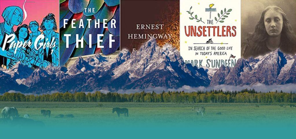 variety of book covers with the Teton mountain range