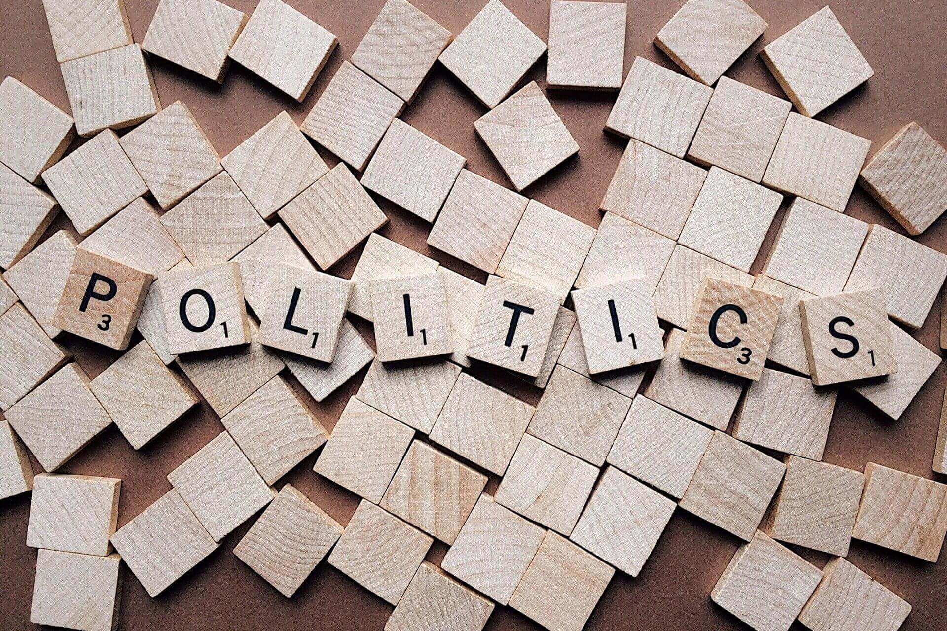 politics spelled out with letter tiles