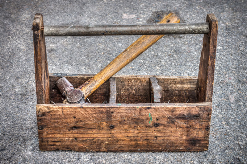 hammer in wooden toolbox
