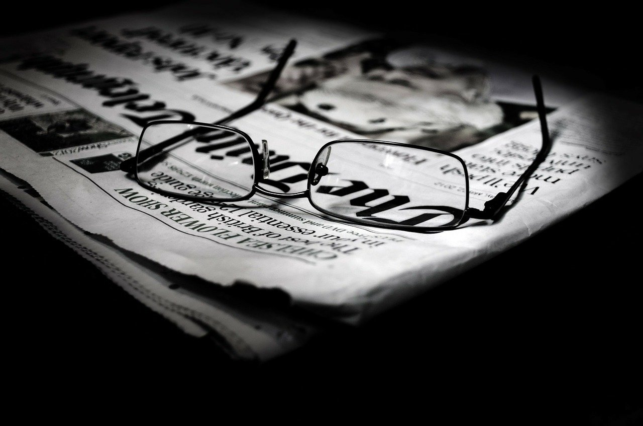 Reading glasses on a newspaper