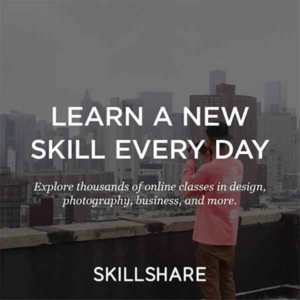 Skillshare advertisement with a person taking a photograph of a city skyline