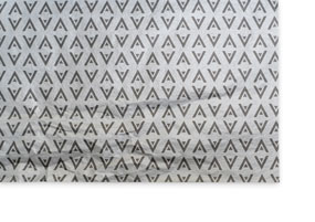 A sheet of metallic silver printed tissue paper