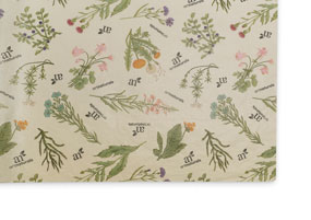 A sheet of tan tissue paper printed with greenery