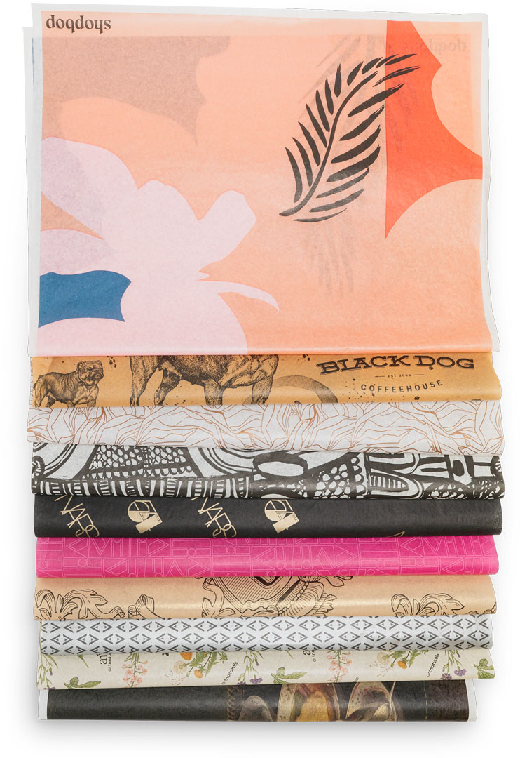 various sheets of custom printed tissue paper