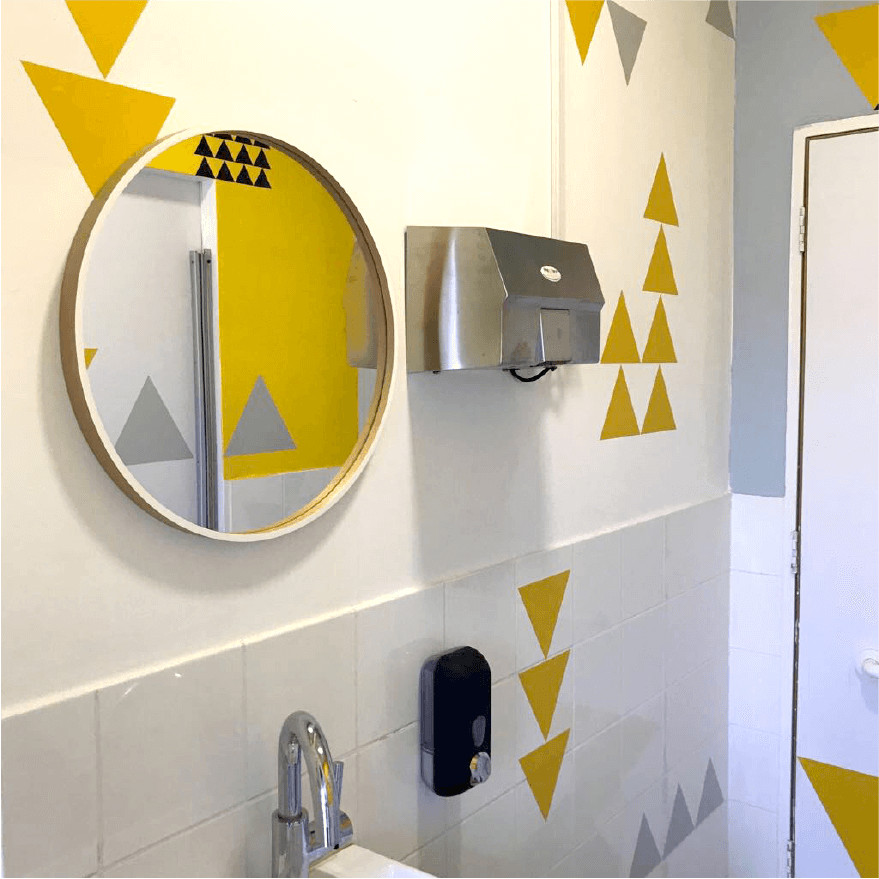 oren lasry tamar bar dayan a mirror on a bathroom wall hevruta branding interior design office co working space