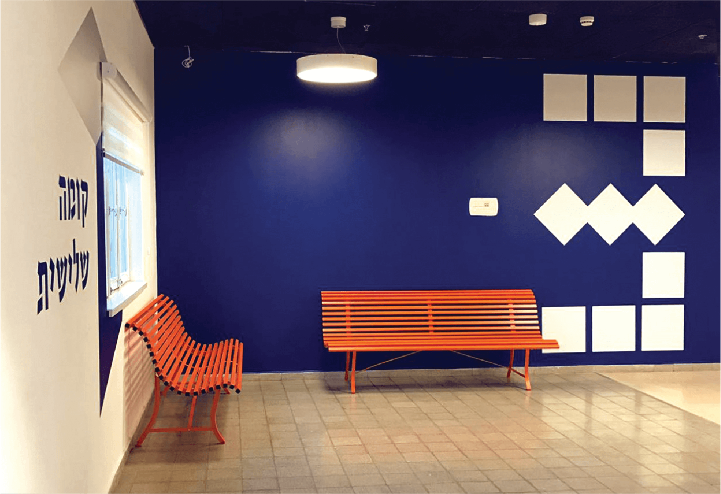oren lasry tamar bar dayan dov hoz Third floor orange bench and blue wall
