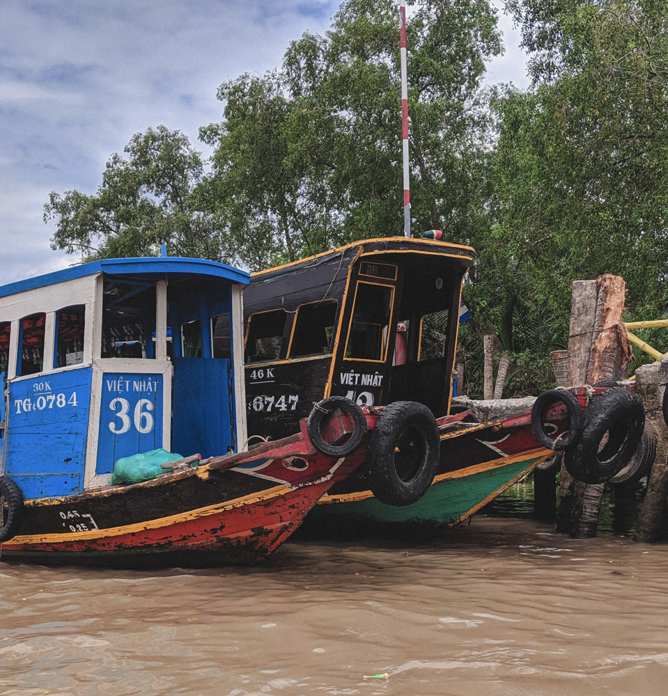 Mekong river boats with eyes