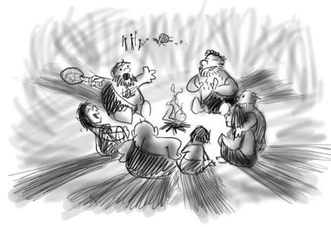 Cavemen telling stories around campfire