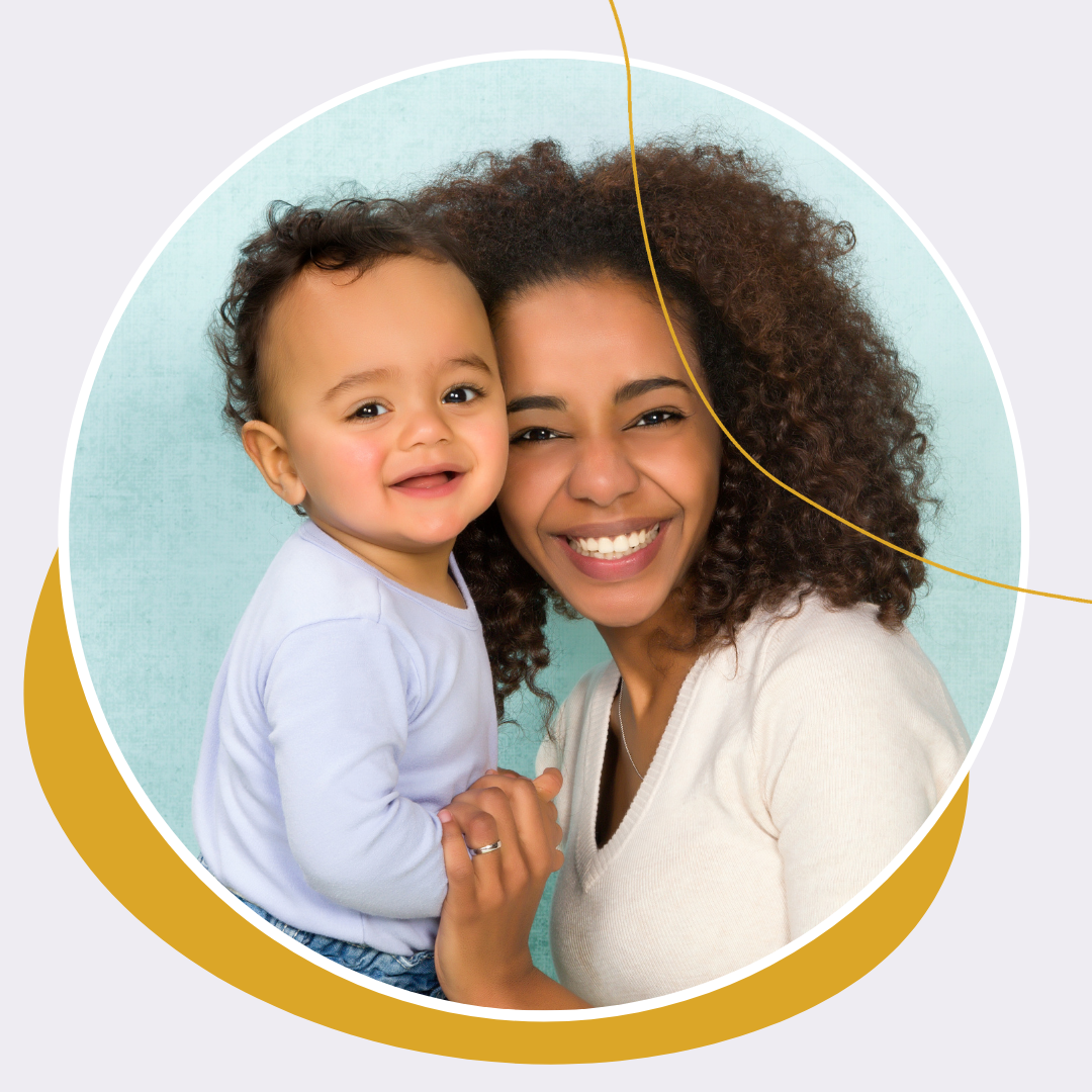 Image of mother with toddler smiling