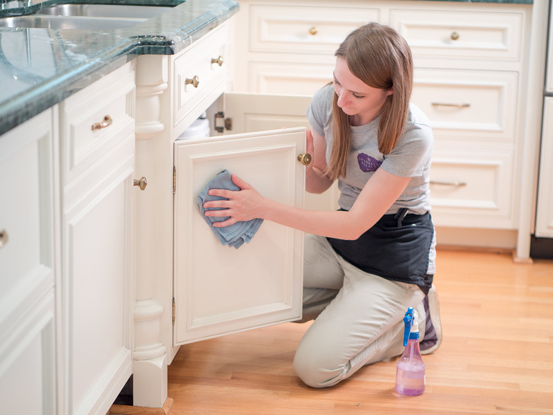 Spot-cleaning the outside of kitchen cabinets