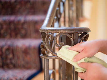 Dusting a wood banister
