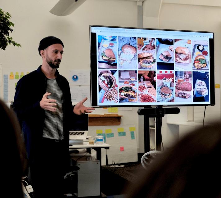 A Digital Arts Network employee presenting his Pecha Kucha