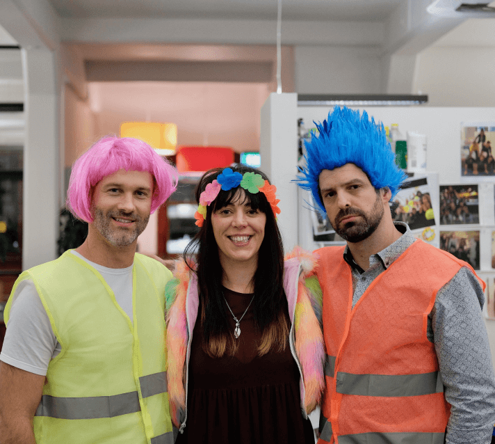 Digital Arts Network employees at a fancy dress party smiling at the camera